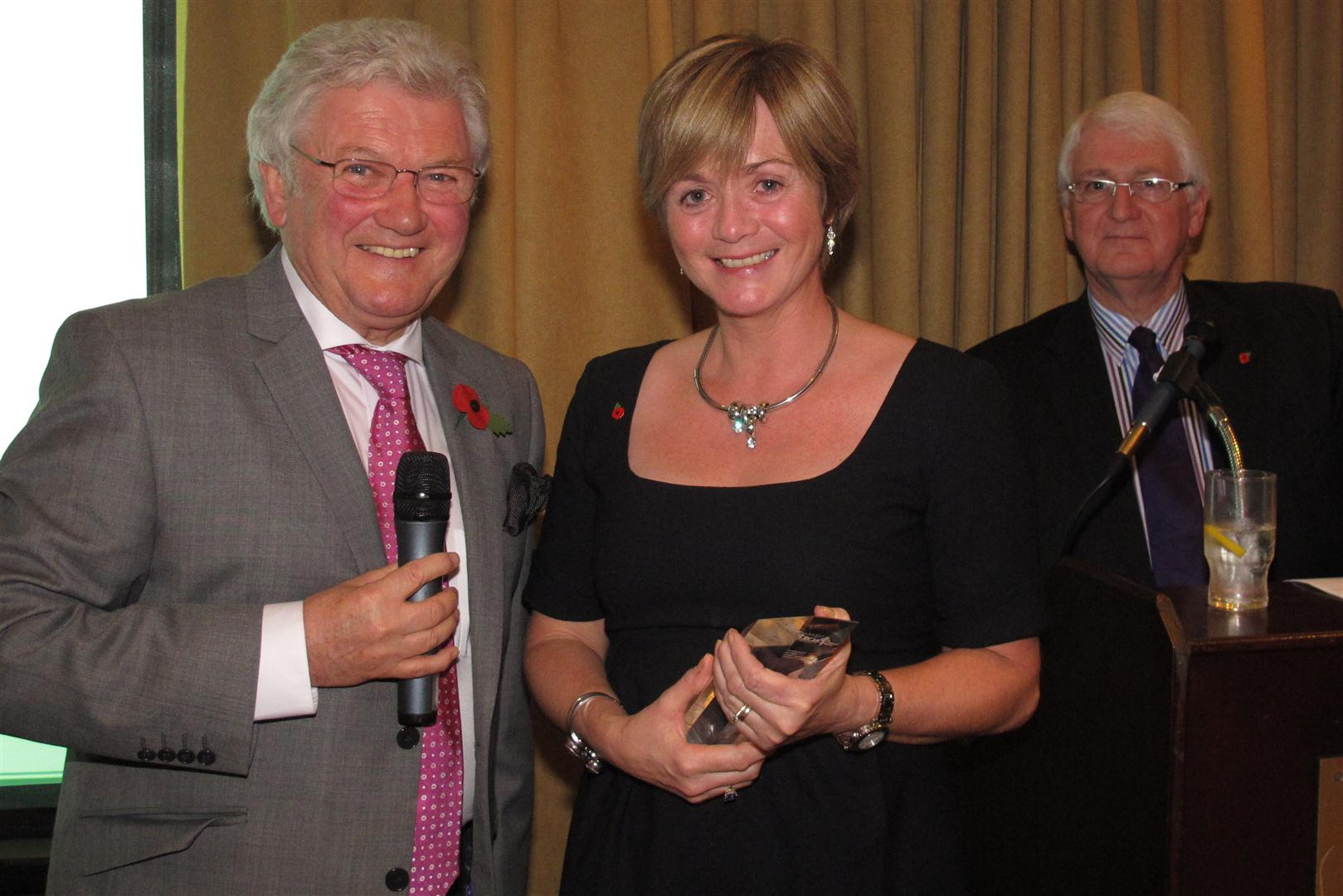 Gillian Chambers collects an award on behalf of Peter